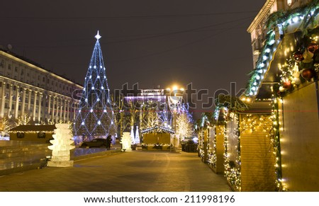 MOSCOW - DECEMBER 28, 2013: Christmas tree and Christmas market on Tverskaya street.  - stock photo