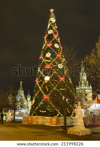 MOSCOW - DECEMBER 19, 2013: Christmas tree on Red square, ice sculptures, St. Basils Intercession cathedral and Spasskaya tower of Kremlin. - stock photo