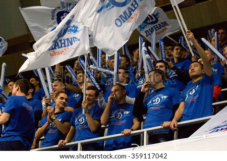 MOSCOW - DECEMBER 2: Fans of Dynamo team on tribunes on a game Dynamo MSK vs Dynamo KZN on Russian National women Volleyball tournament on December 2, in Moscow, Russia, 2015 - stock photo
