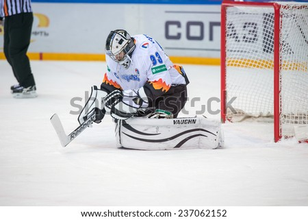 MOSCOW - DECEMBER 3: Goalkeeper Jakub Stepanek (33) on game CSKA vs Severstal on Russian KHL premier hockey league Championship on December 3, 2014, in Moscow, Russia. CSKA won 9:1 - stock photo
