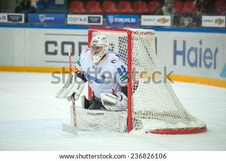 MOSCOW - DECEMBER 3: Goalkeeper Sergei Magarilov (83) on game CSKA vs Severstal on Russian KHL premier hockey league Championship on December 3, 2014, in Moscow, Russia. CSKA won 9:1 - stock photo