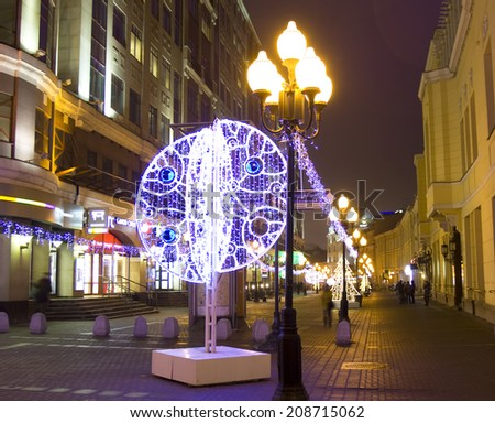MOSCOW - DECEMBER 29, 2013: illumination for Christmas and New Year holidays on Old Arbat street. - stock photo