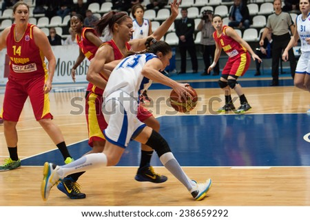 MOSCOW - DECEMBER 4, 2014: Irina Sokolovskaya (13) in action during the International Europe bascketball league match Dynamo Moscow vs Maccabi Ashdod Israel in Moscow, Russia. Dynamo loss 59:67 - stock photo