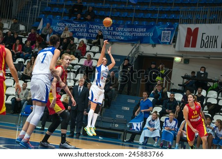 MOSCOW- DECEMBER 4, 2014: Irina Sokolovskaya (13) in action during the International Europe bascketball league match Dynamo Moscow vs Maccabi Ashdod Israel in sport palace Krilatskoe, Moscow, Russia.  - stock photo