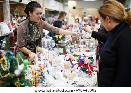 MOSCOW - DECEMBER 09, 2012: Seller at Christmas fair of handmade products on December 09, 2012, Moscow, Russia