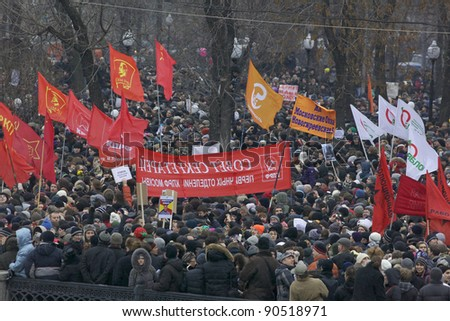 MOSCOW - DECEMBER 10: 50 thousands in Moscow protest Putin and election results  on Bolotnaya Square. Biggest protest in Russia for the last 20 years, December 10, 2011 in Moscow, Russia. - stock photo