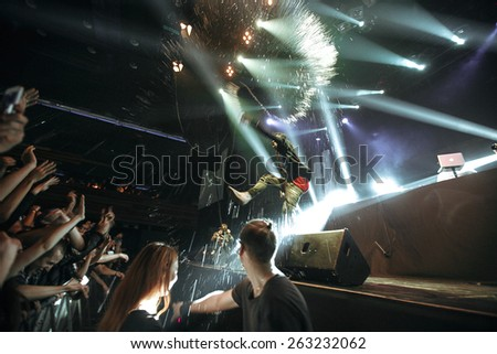 MOSCOW - 6 December,2014 : Travis Scott performing live music show concert on night club stage.Famous rapper on scene.Rap & trap star sing on stage.Hip hop singer in bright stage lights in nightclub