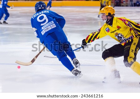 MOSCOW - DECEMBER 12, 2014: Tukavin A. (9) in action during the Russian  bandy league game Dynamo Moscow vs SKA Neftyanik in sport palace Krilatskoe, Moscow, Russia. Dynamo won 9:1 - stock photo