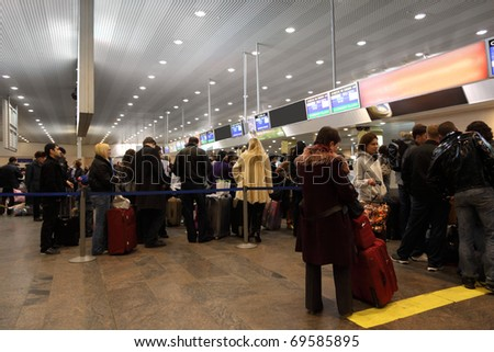 MOSCOW - DECEMBER 29: Turns to the registration desk at the airport Sheremetyevo, December 29, 2009, Moscow, Russia. - stock photo