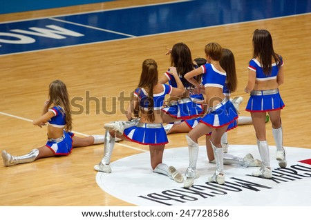 MOSCOW - DECEMBER 4, 2014: Unidentified cheerleaders dance on the timeout on the International Europe bascketball league game Dynamo Moscow vs Maccabi Ashdod in sport palace Krilatskoe, Moscow, Russia - stock photo