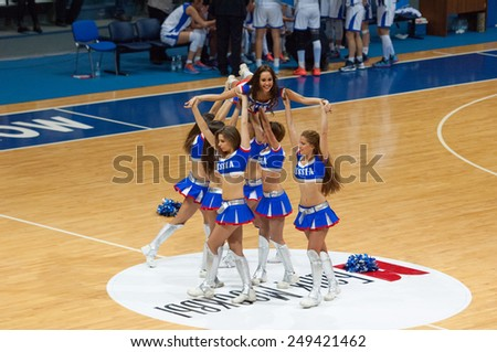MOSCOW - DECEMBER 4, 2014: Unidentified cheerleaders in pyramid during the International Europe bascketball league match Dynamo Moscow vs Maccabi Ashdod in sport palace Krilatskoe, Moscow, Russia - stock photo