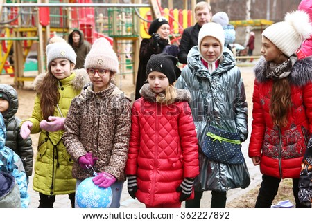MOSCOW, DECEMBER 26, 2015: Unidentified childen participate in Christmas animated event with Father Frost and other fairy tale characters. Thay play games and get presents in Moscow, December 26, 2015