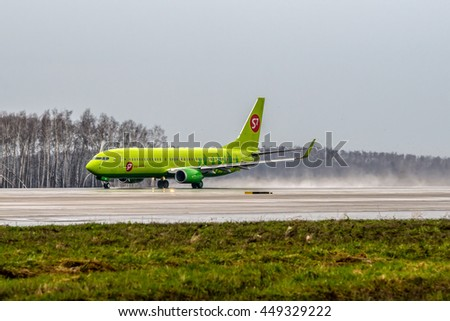 Moscow, Domodedovo airport, Russia - April 24, 2013: Boeing 737-800 S7 - Siberia airlines VP-BND taking off at Domodedovo international airport at heavy rain
