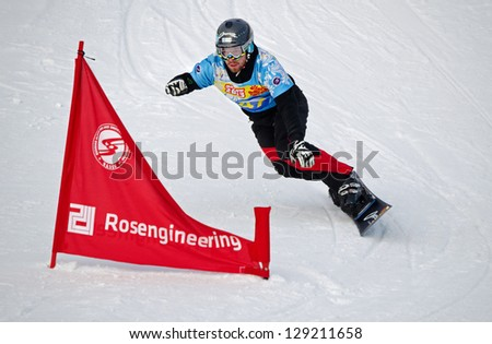 MOSCOW - FEB 23: Jure Hafner (Slovenia) on a line of World Cup FIS  on a snowboard in a parallel slalom on February 23, 2013 in Moscow, Russia.