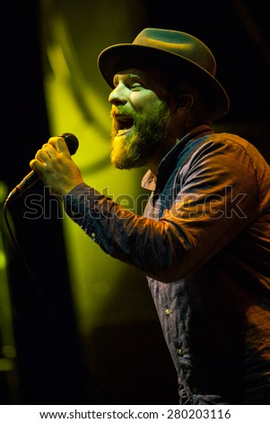 MOSCOW - 12 FEBRUARY,2015 : Alex Clare playing live concert in night club.Famous guitar player and singer play music show in nightclub on stage.Bright stage lighting,performer on scene with guitar