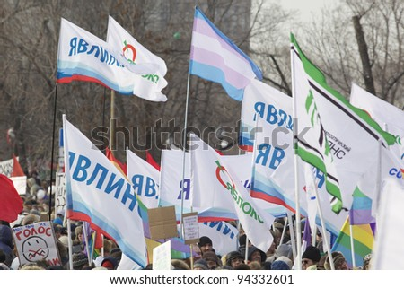 MOSCOW - FEBRUARY 4: Anti-Putin protesters march through Moscow February 4, 2012 in Moscow, Russia. Up to 120,000 Russian anti-government protesters demand political reform. - stock photo