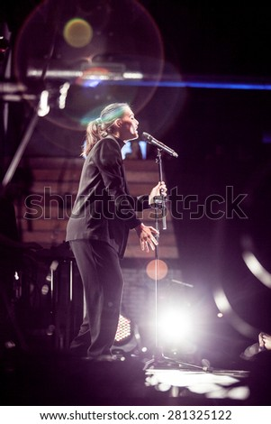 MOSCOW - 16 FEBRUARY,2015 :Famous singer Jessie Ware performing live in nightclub.Woman sing on stage.Pop singer on scene.Bright stage lighting,night club stage lights.Vocalist live music performance