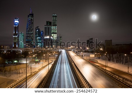 MOSCOW - FEBRUARY 08: Moscow City skyscrapers at full moon night, February 08, 2015, Moscow, Russia - stock photo