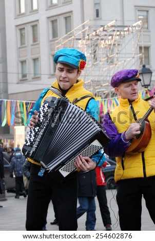 MOSCOW - FEBRUARY 21, 2015: Music band performs on the street. They play balalaika and accordion. Shrovetide celebration in Moscow city center. - stock photo
