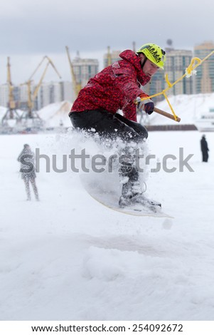 MOSCOW - FEBRUARY 07:  wakeboarder performing a stunt at Ice Wakeboarding contest in Moscow,  February 07, 2015, Moscow, Russia
