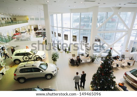 MOSCOW - JAN 11: Top view of the showroom on the first floor of dealership of Volkswagen Center Varshavka January 11, 2013, Moscow, Russia. Building of the center contains a three floor - stock photo