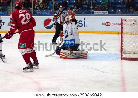 MOSCOW - JANUARY 10: Goalkeeper Cal Heeter (34) in action on hockey game Vityaz vs Medvezchak on Russian KHL premier hockey league Championship on January 10, 2015, in Moscow,Russia. Medvezcak won 3:2 - stock photo