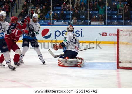 MOSCOW - JANUARY 10: Goalkeeper Cal Heeter (34) in action on hockey game Vityaz vs Medvezchak on Russian KHL premier hockey Championship on January 10, 2015, in Moscow, Russia. Medvezcak won 3:2 - stock photo
