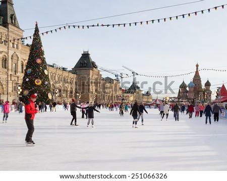 Moscow - 16 January 2015: Happy people skate on the rink for the Christmas holidays on the Red Square and decorated Christmas tree Jan. 16, 2015, Moscow, Russia - stock photo
