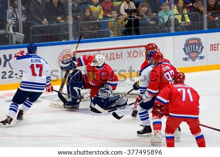 MOSCOW - JANUARY 29, 2016: M. Mikhaylovsky (20) save the gate on hockey game Finland vs Russia on League of World legends of Ice hockey championship in VTB ice arena, Russia. Russia won 6:2 - stock photo