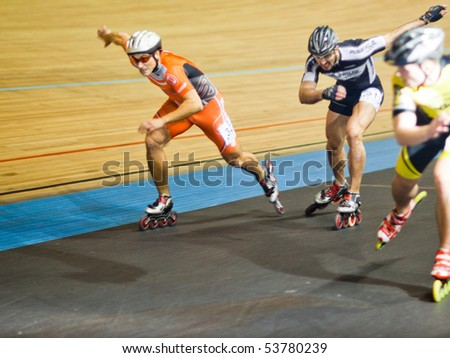 MOSCOW - JANUARY 08: Olympic bicycle arena, Sergey Minin, Alexey Grigoriev, and Vitaly Gatsko runs the race, shallow DOF, focus on left person - Annual Christmas Run on January 08, 2010 in Moscow