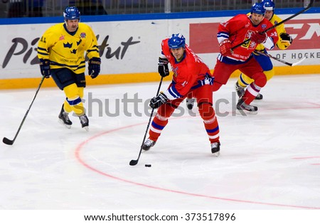 MOSCOW - JANUARY 29, 2016: Richard Zemlicka (13) in action during hockey game Sweden vs Czech on League of World legends of Ice hockey championship in VTB ice arena, Russia. Czech won 8:2 - stock photo