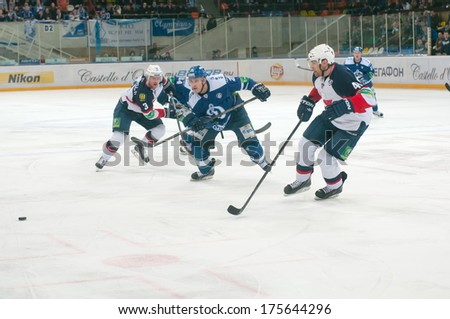 MOSCOW - JANUARY 28, 2014: Unidentified players (Dynamo (blue) and Slovan (white) in the KHL regular Hockey match Dynamo (Moscow) - Slovan (Bratislava) in sports palace Luzhniki. Final score 2:3