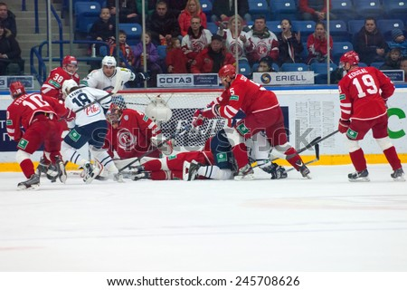 MOSCOW - JANUARY 10: Unidentified players in action on hockey game Vityaz vs Medvezchak on Russian KHL premier hockey league Championship on January 10, 2015, in Moscow, Russia. Medvezcak won 3:2 - stock photo