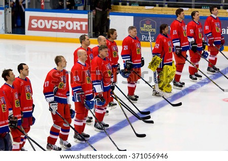 MOSCOW - JANUARY 29, 2016: Unidentified players of Czech team just before hockey game Sweden vs Czech on League of World legends of Ice hockey championship in VTB ice arena, Russia. Czech won 8:2 - stock photo
