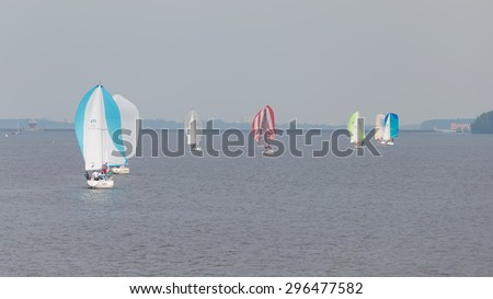 Moscow - July 9, 2015: A lot of bright beautiful sailboats on Klyazma reservoir swim summer July 9, 2015, Moscow, Russia