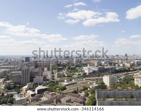 Moscow - 25 July 2015: Aerial view of Moscow and in the distance the skyscrapers Moscow City and District Sokolniki June 25, 2015, Moscow, Russia - stock photo