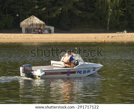 MOSCOW - JULY 20, 2014: boat with life-guard on beach in Serebryany bor (Silver forest) on Moskva-river, one of the most popular beaches of the city. - stock photo