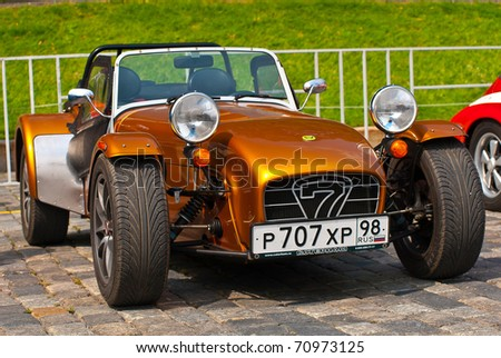 """MOSCOW -JULY 10: Bronze Caterham Seven Sport Cars on display at the start annual Rally of classical cars  """"Zolotoe kol'co"""" on Red Square on July 10, 2010 in Moscow, Russia - stock photo"""