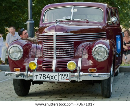MOSCOW - JULY 31:Dark  Red Opel Kapit 1939 on exhibition parking at an annual event the VI race of vintage cars 'Night Moscow Classic Rally'. July 31, 2010 in Moscow, Russia - stock photo