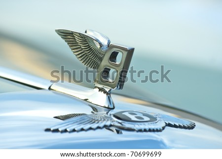 MOSCOW-JULY 31:  Figure-emblem Bentley on a car cowl. Annual event 'Night Moscow Classic Rally', the VI race of vintage cars, from owners to celebrities. July 31, 2010 in Moscow, Russia - stock photo