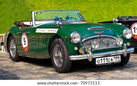 """MOSCOW -JULY 10: Green Austin Healey 3000 Mk II (1962) on display at the start annual Rally of classical cars  """"Zolotoe kol'co"""" on Red Square on July 10, 2010 in Moscow, Russia - stock photo"""