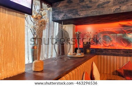 "MOSCOW - JULY 2014: Interior is a stylish chain restaurant of Japanese and Italian cuisine ""NIOKKI"". Decorations from dried flowers in vases on the shelf of the restaurant"