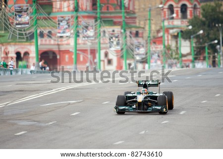MOSCOW - JULY 17: Karun Chandhok of Team Lotus competes at the Bavaria Moscow City Racing 2011 at Kremlin embankment on July 17, 2011 in Moscow, Russia. - stock photo