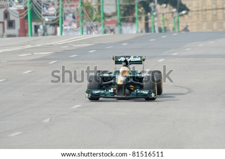 MOSCOW - JULY 17: Luiz Razia of Team Lotus at Bavaria Moscow City Racing 2011 at Kremlin embankment July 17, 2011 in Moscow. - stock photo