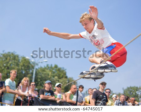 MOSCOW - JULY 31: Luzhniki Olympic arena, Aleksey Gulyagin performs a jump - Annual Russian Rollerskating Federation Contest on July 31, 2010 in Moscow - stock photo