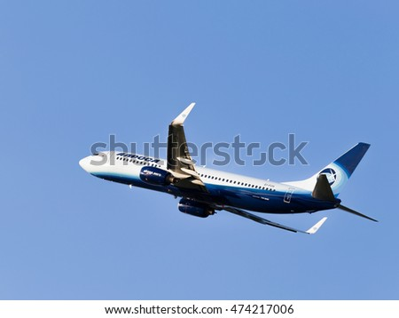 Moscow - July 31, 2016: passenger plane Boeing 737-83N / W Alrosa-Avia airline flies to Domodedovo airport and on a background of blue sky July 31, 2016, Moscow, Russia