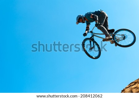 MOSCOW - JULY 26: Unidentified BMX rider making a bike jump during Moscow City Games in Luzhniki on July 26, 2014 in Moscow.