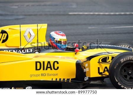 MOSCOW - JULY 18: Vitaly Petrov of Renault F1 Team competes at the Bavaria Moscow City Racing 2010 at Kremlin embankment on July 18, 2010 in Moscow, Russia - stock photo