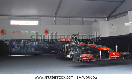 MOSCOW - JULY 20: Vodafone McLaren Mercedes sport car at Moscow City Racing. Formula 1 teams show in historical city center of Moscow. Taken on July 20, 2013 in Moscow, Russia.  - stock photo
