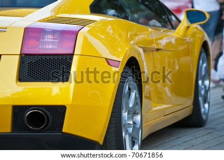 MOSCOW - JULY 31: Yellow Lamborghini on exhibition parking at an annual event the VI race of vintage cars 'Night Moscow Classic Rally'. July 31, 2010 in Moscow, Russia - stock photo